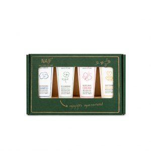 Naïf miniset met hierin een kleine tubetjes shampoo, bodylotion, nurturing crème, wasgel in een donker groen doosje